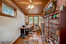Ground floor office/den. Large enough for a work area, couch, and TV.