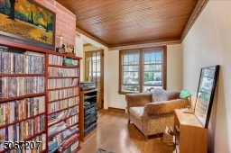 Located just off the living room, french doors offer privacy.  Lots of windows bring in natural light and nice breezes.