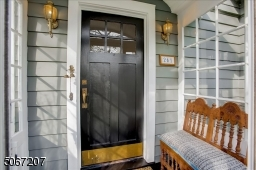 Don't ever get caught in the rain again while fumbling for your keys.  This quaint glass enclosed vestibule is a great day to be protected from the unwanted elements when entering the home.