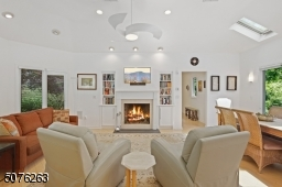 With a gas fireplace, built-in bookshelves and vaulted ceiling.