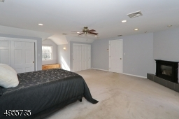 Master bedroom featuring gas fireplace