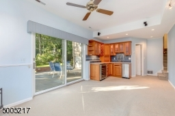 Updated with cabinets, granite counter, wine refrigerator, ice maker.