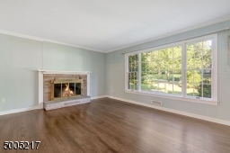 Refinished hardwood floors, fireplace and large picture window