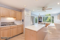 Center Island and Breakfast Bar with corian counter, ample cabinetry and double pantry. Refinished floors.Double oven.