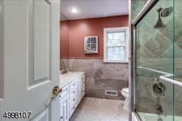 Updated Main Bath on 2nd floor.  Notice the special detail with  shower and tub