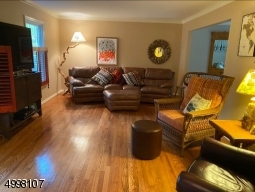 Spacious living room with gleaming hard wood floors