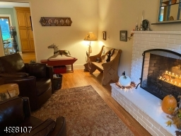 Family Room with fire place and hardwood floors