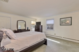 Large walk in closet and stall shower en suite Bath