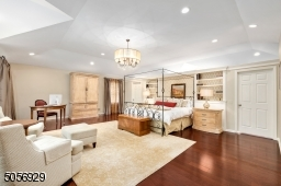 This room is truly spectacular! From its interesting ceiling lines, built in book cases,a dressing room, 2 walk in closets, mahogany floors and just steps from the master bath.
