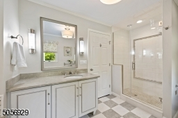 Another view, vanity with limestone countertops and Kohler sink.