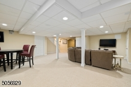 Lower level has been refinished and has plenty of space for additional entertaining, fun and games.