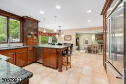 Handsome Cherry cabinetry, granite countertops and high end SS appliances including a built in French door refrigerator and beverage fridge.