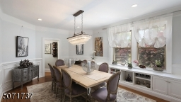 formal dinning room seat 8-10 people with custom builtins under the window, wainscot panels, picture molding and stunning 500 crystals chandelier