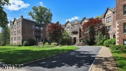 Exquisite old charm architectural riverfront condo with circle driveway