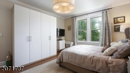 with beautiful custom built-in closet and quite tree-line side exposure view