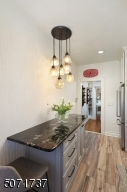 gourmet eat-in kitchen with custom cabinetry, counter high island