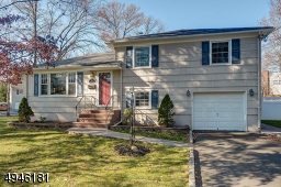 This lovely, updated split-level is nestled on a serene stretch of property in the beautiful Township of Cranford.