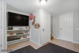 Family Room is serviced by a full bath & offers access to the attached garage.