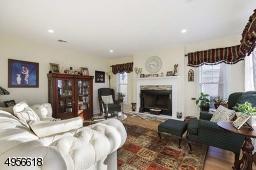 with fireplace, hardwood floor