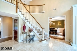 WOW! Soaring ceilings, and a stunning stone flooring.