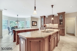 One of the nicest kitchens i've seen. heated flooring, granite and limestone counter tops, and a wall of windows bringing the outside in. Don't forget the desk!