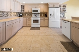 Large Eat In Kitchen with Plenty of Counters and Cabinets