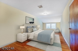 Here is one of the bedrooms with a view to the backyard. Large walk in closet. Virtually Staged.