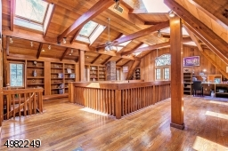 Venture up the spiral staircase to the 2nd level of the library. It is ideal for a home office and quiet retreat, or whatever you choose. And when you open the door, you will discover that you've just entered the MBR dressing area!