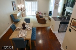 Beautiful hardwood floors welcome you into the lovely dining area, beautiful kitchen with breakfast bar and spacious living room.