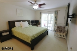 Spacious and sunny master bedroom.