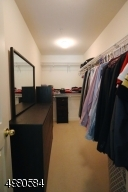 A walk in closet provides ample room for you wardrobe.