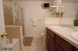 A spacious en-suite is complete with a double vanity, jetted tub and stall shower.