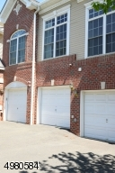 Protect your car from the elements in this attached garage which leads directly to the interior mudroom and laundry room.