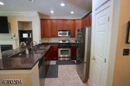 Your kitchen is complete with stainless appliances, granite countertops, a self-cleaning oven, garbage disposal and pantry.