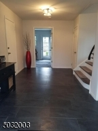 Large entry foyer with coat closet and access to garage and basement,