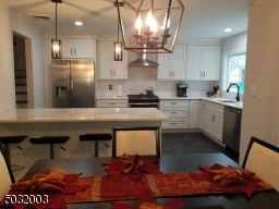 Spacious kitchen with island that seats 4. Lots of light!