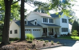Pristine 4BR 3FB custom Colonial home located in desirable Laurel Park - just blocks from NYC train, bus & school.