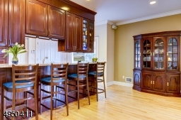 Breakfast bar and adjacent area offer casual dining and are open to the Great Room.