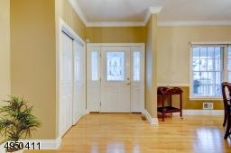 Gracious entry foyer.  Wood floor, double guest closet.