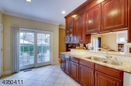 Top of the line appliances include Viking refrig, with custom cabinetry doors, double drawer Fisher & Paykel brushed stainless steel dishwasher, built-in KitchenAid microwave & oven combination w/convection. Fisher & Paykel stainless steel gas cooktop.