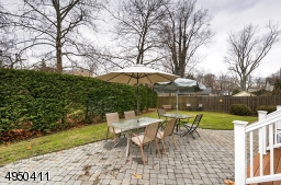 Backyard offers a park-like setting.  Enjoy a  large paver Patio with access from Kitchen & Great Room.