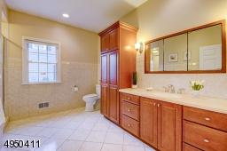 Convenient and attractively done with porcelain floor, large shower, vanity w/Corian counter, built-in cabinet.