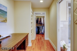 Sitting room or office - or possible nursery!  Built-in shelves.  Leads to huge walk-in closet-w/built-in shelving.