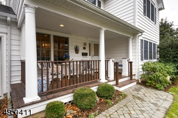 Rocking chair friendly front porch!  Very warm & welcoming with mahogany floor and railings.