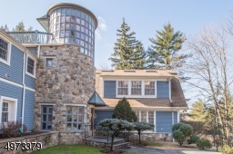 Located on 1.5 acres of wooded land on cul-de-sac in desirable Pine Way Farms, this nearly 8000 sq ft home sits high above the long welcoming driveway w/ utmost privacy & grandeur.