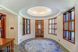 Step inside this unique foyer and let the magic of this impressive home unfold!