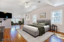 Master bedroom is not only spacious, but offers its own suite of additional spaces to retreat to.  There are 2 dressing areas, a silo that leads to the rooftop deck, and a private entrance into the 2nd-level of the library! Virtually Staged.
