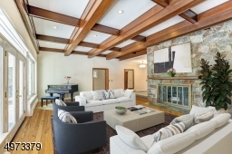 There is an entire wall of windows that overlooks the patio and the beautifully landscaped backyard.  And of course, the pool! Virtual Staged.