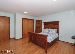 Bedroom located on first floor with view of th pool.
