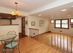 Step down to the family room with recessed lighting.